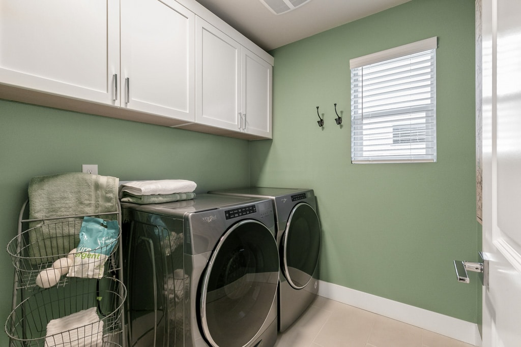 Upper cabinets included in this laundry room