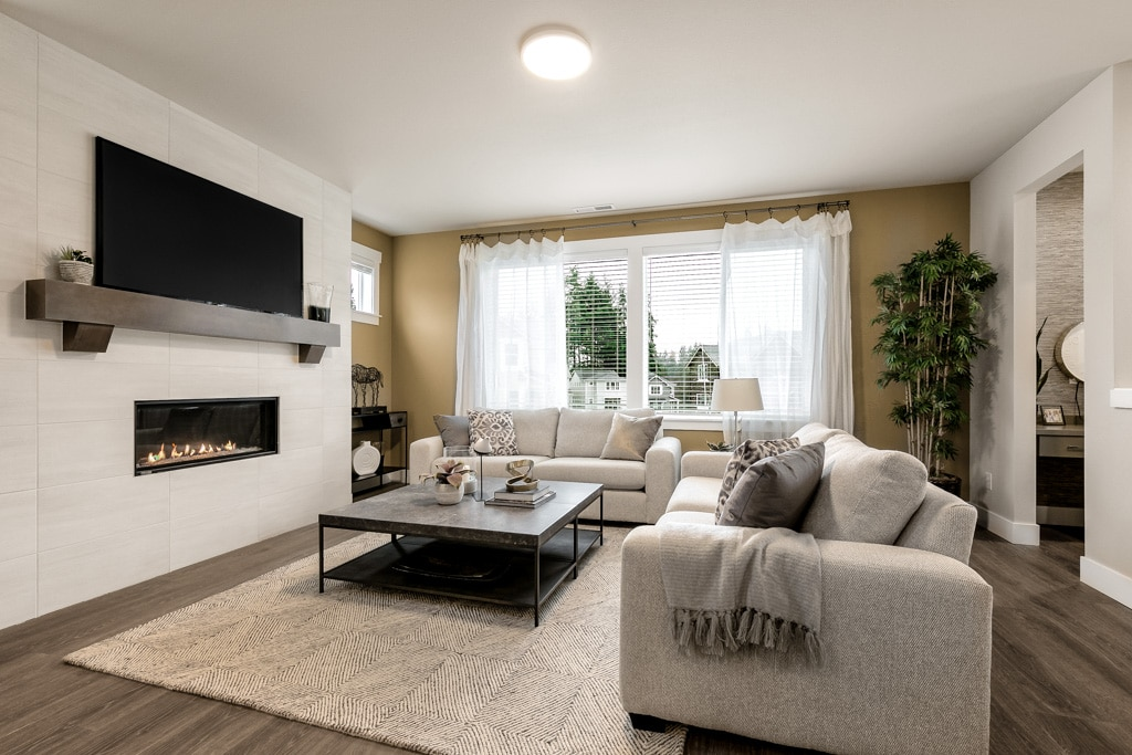 Great room centers around the contemporary gas fireplace