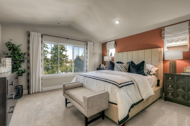 Vaulted ceilings and extra-large windows in the master bedroom.