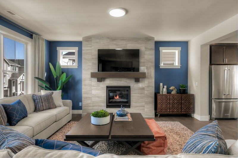 Gas fireplace with floor-to-ceiling tile surround.