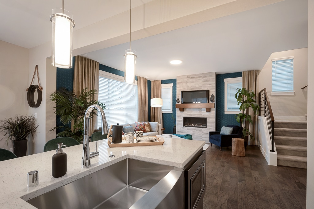 Great room with kitchen at furnished model home of Harbour Crossing in Everett
