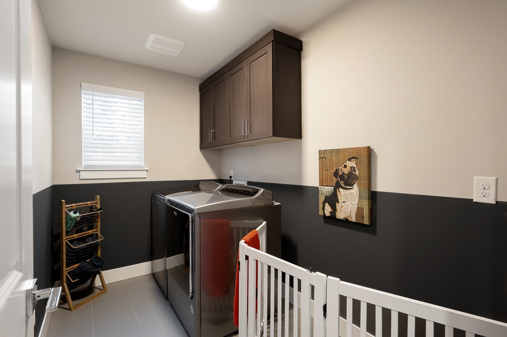 Laundry has extra storage space and built-in upper cabinets.