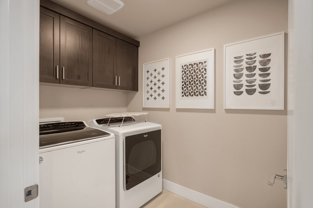 Laundry room has built-in upper cabinets included.