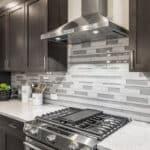 KitchenAid gas range and stainless steel hood
