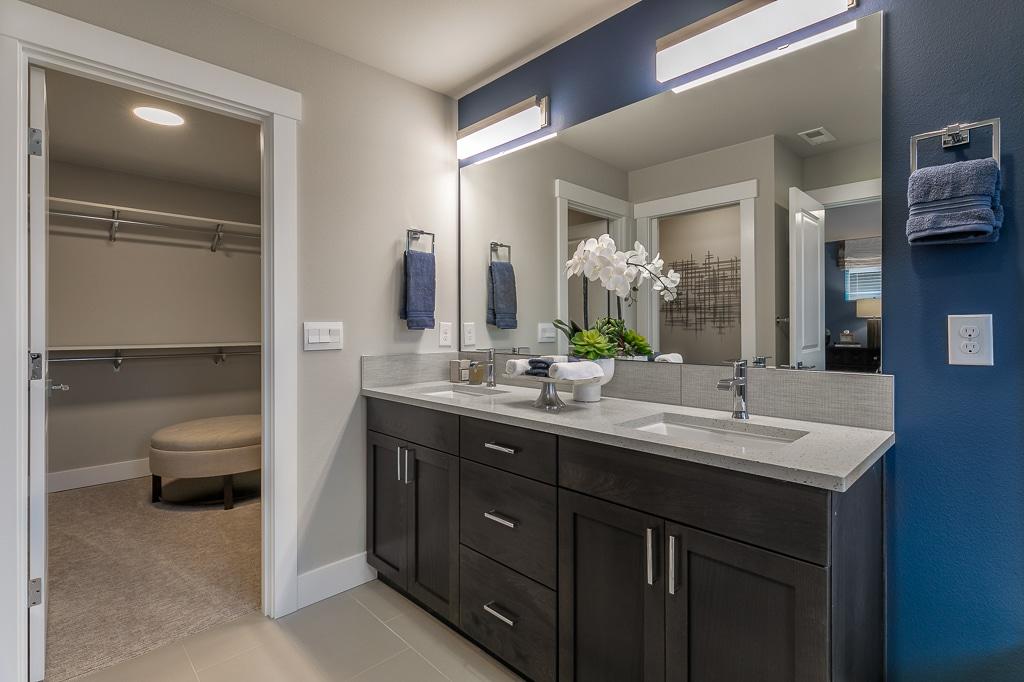 Dual sink vanity with slab quartz countertops