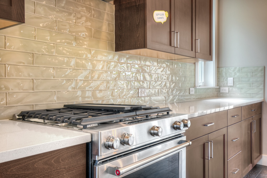 KitchenAid gas range and full-height backsplash