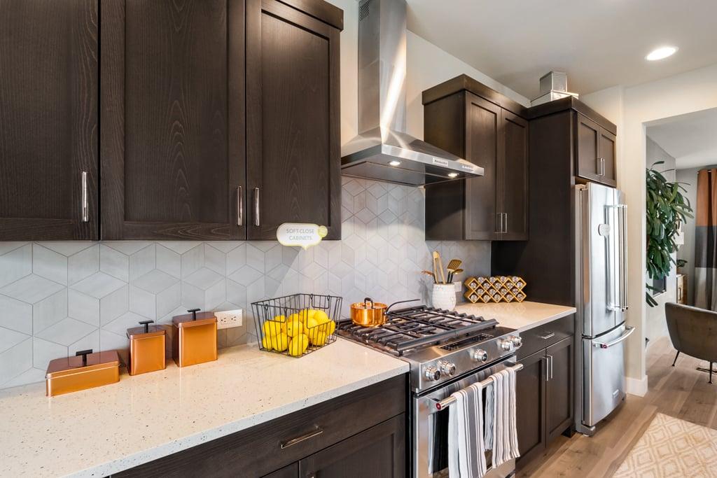 Full-height tile backsplash, soft-close cabinets