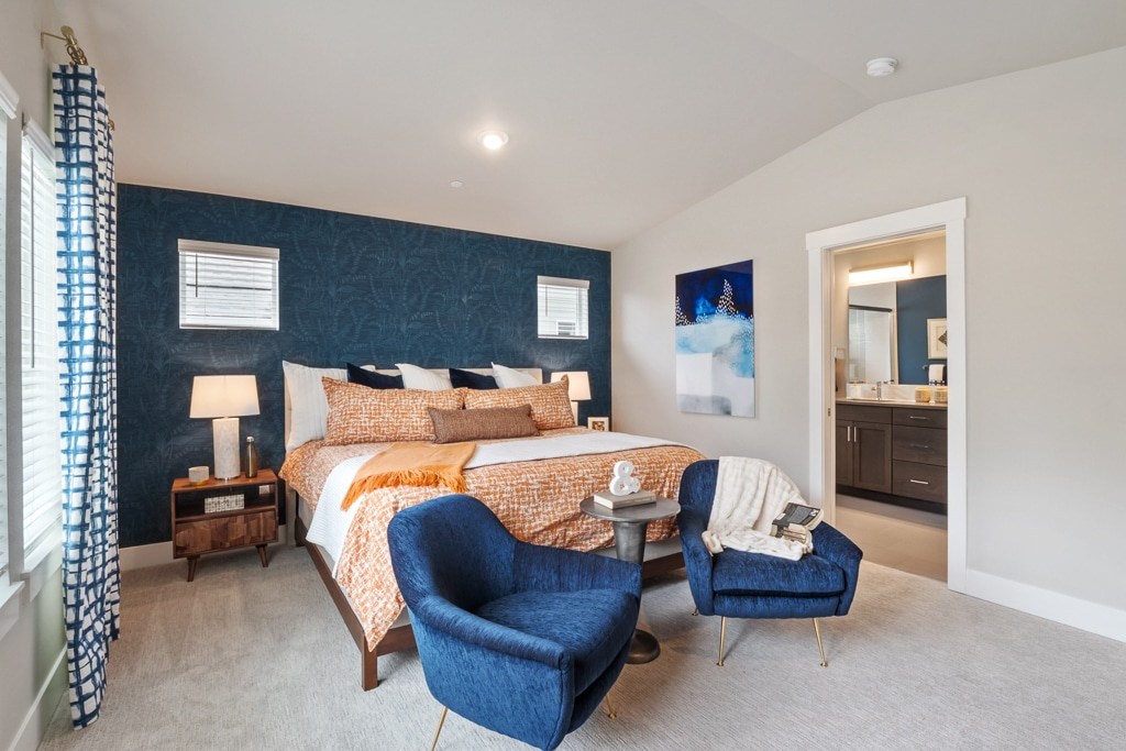 Nice big primary bedroom with space for your king-sized bedroom set and seating for your morning coffee