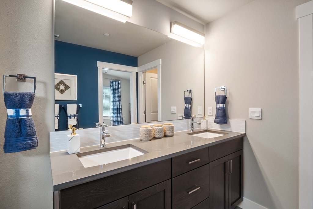 Dual sink vanity with slab quartz countertop