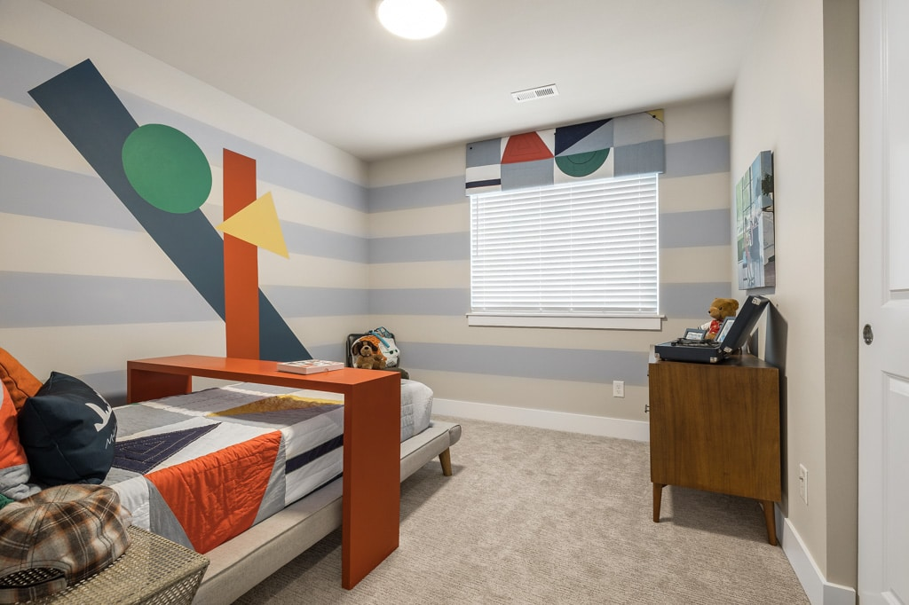 Two more spacious secondary bedrooms on the top floor