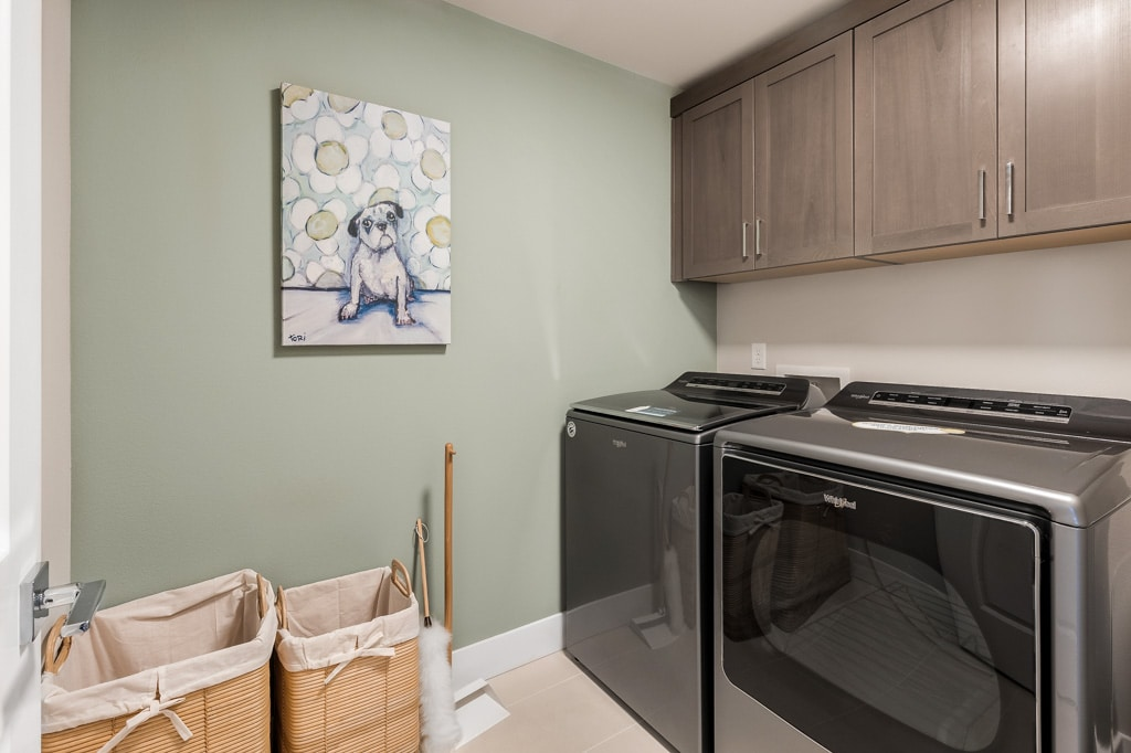 Laundry room with upper cabinets (included) and room for side-by-side washer/dryer (optional upgrade)