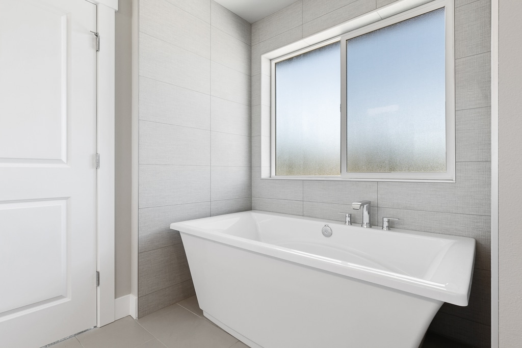 Freestanding soaking tub in primary bath